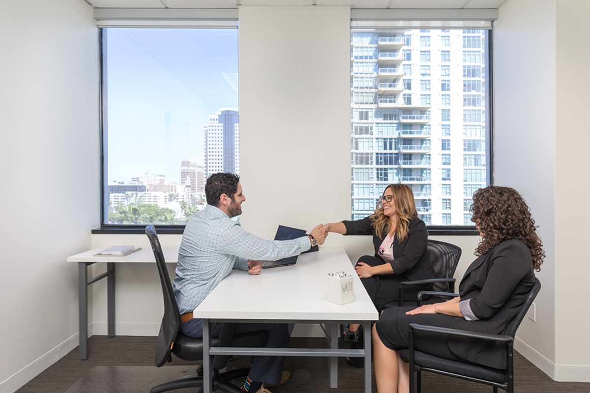 Three people meeting in an office.